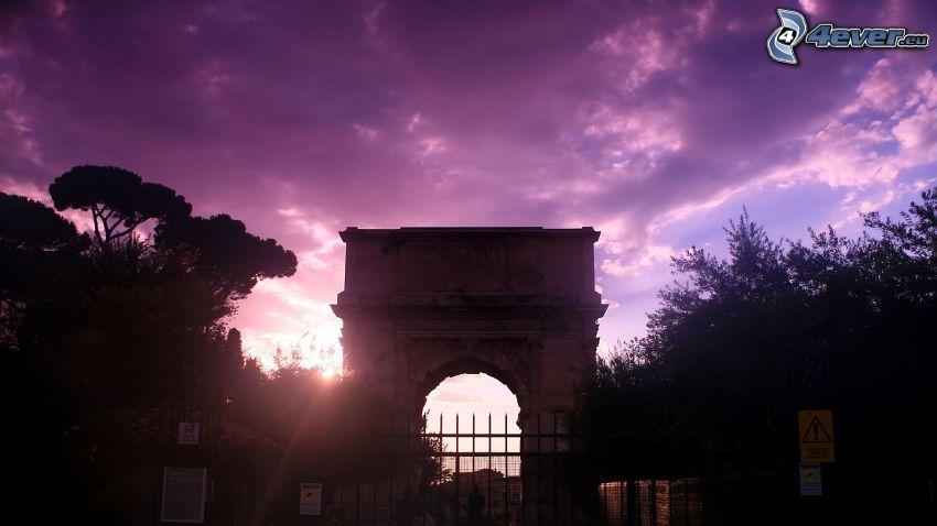 Arco de Triunfo, cielo púrpura, puesta del sol