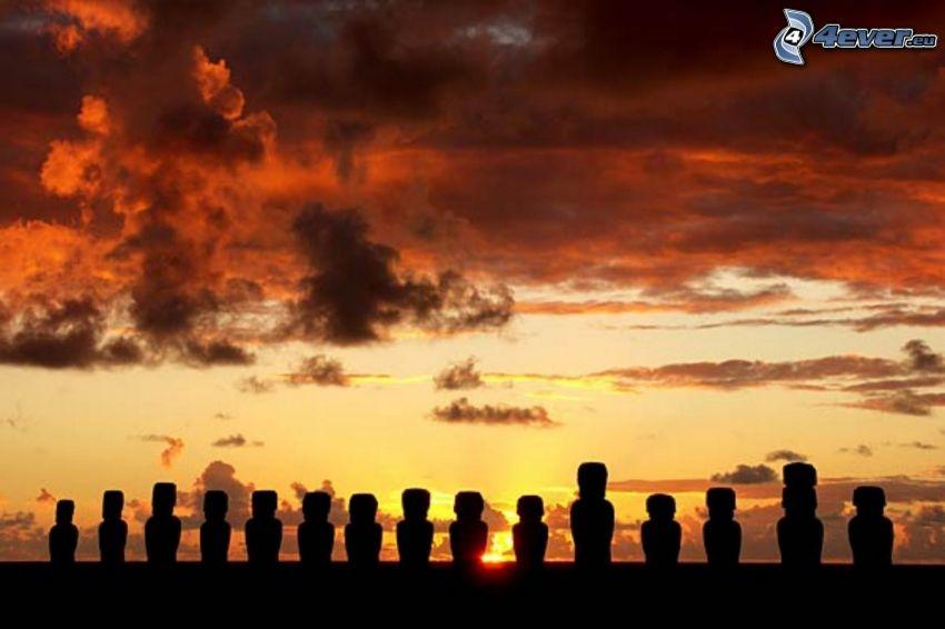 la escultura de Moai, siluetas, puesta del sol, cielo anaranjado, islas de pascua