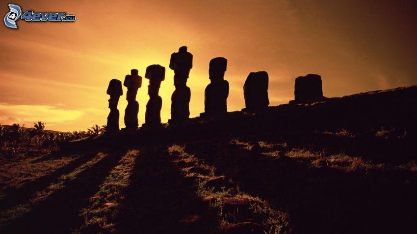 la escultura de Moai, siluetas, puesta del sol, islas de pascua
