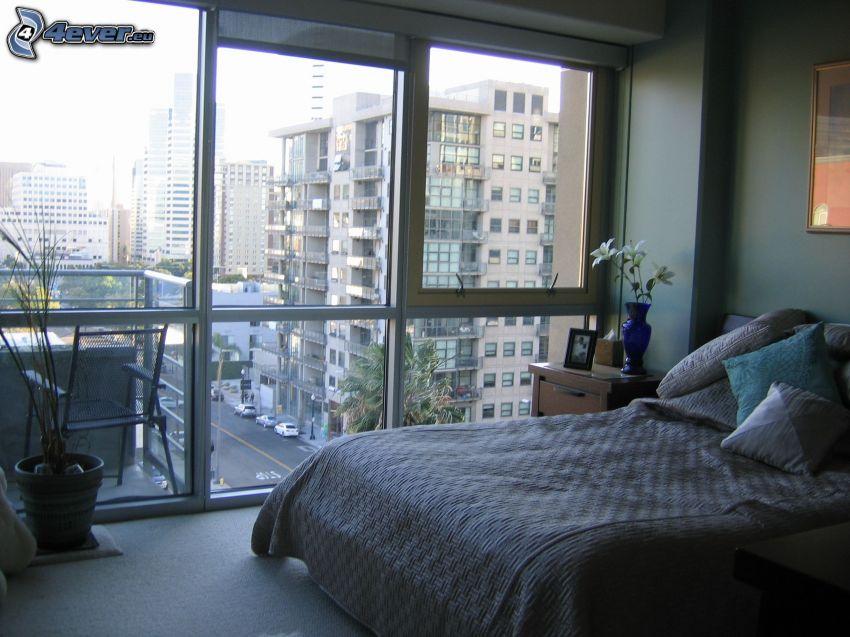 dormitorio, cama doble, vistas a la ciudad