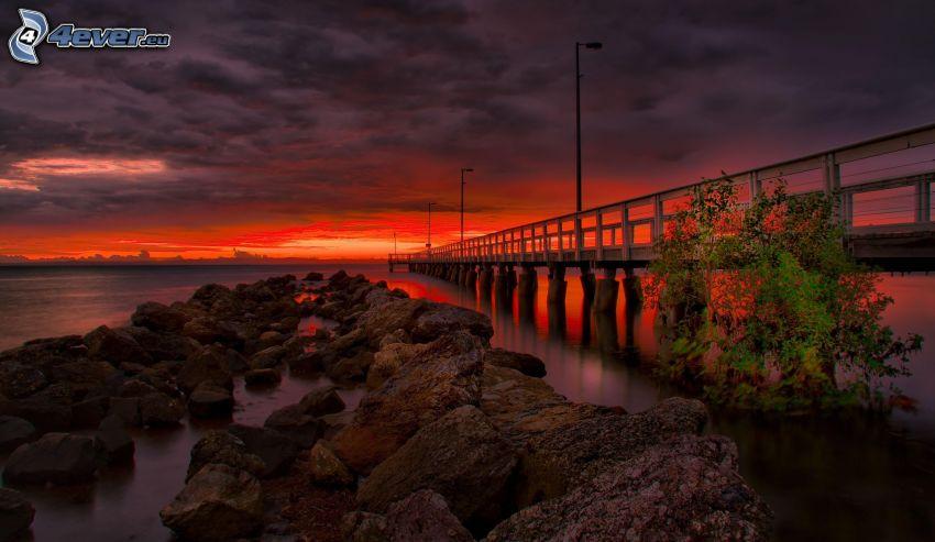 puente, rocas, río, puesta de sol anaranjada