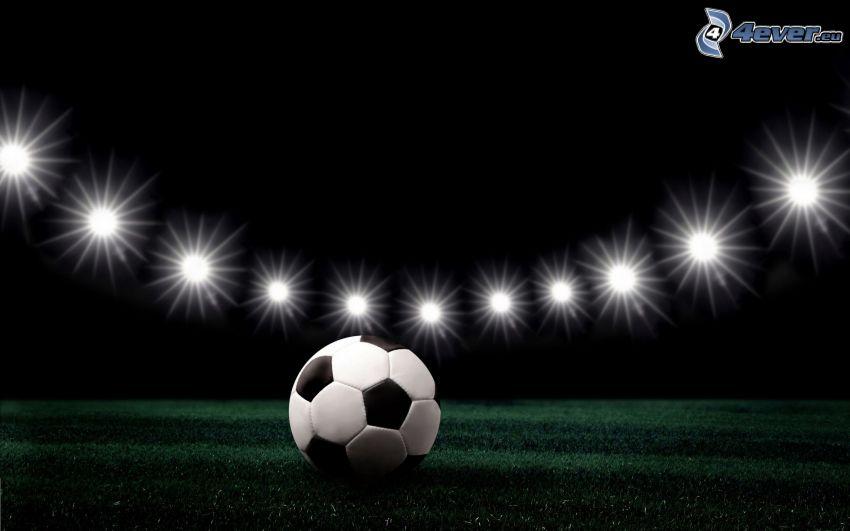 balón de fútbol, césped, luces