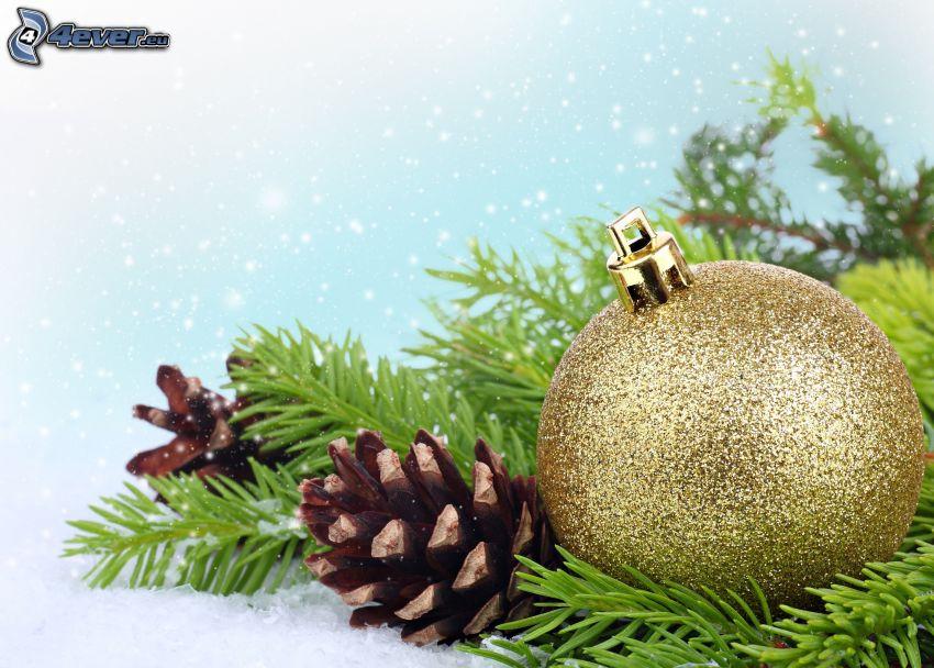Bola de Navidad, ramita de coníferas, conos, nieve