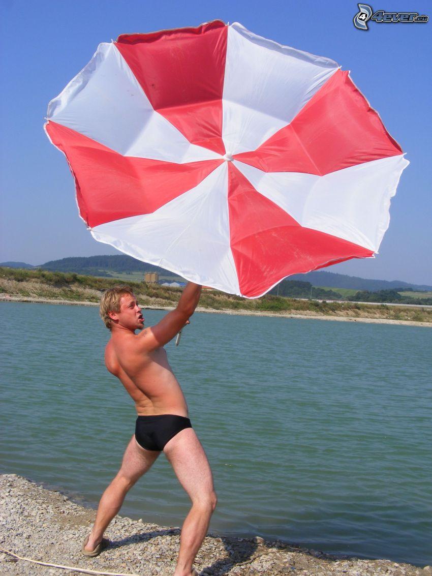 sombrilla, viento, hombre, playa