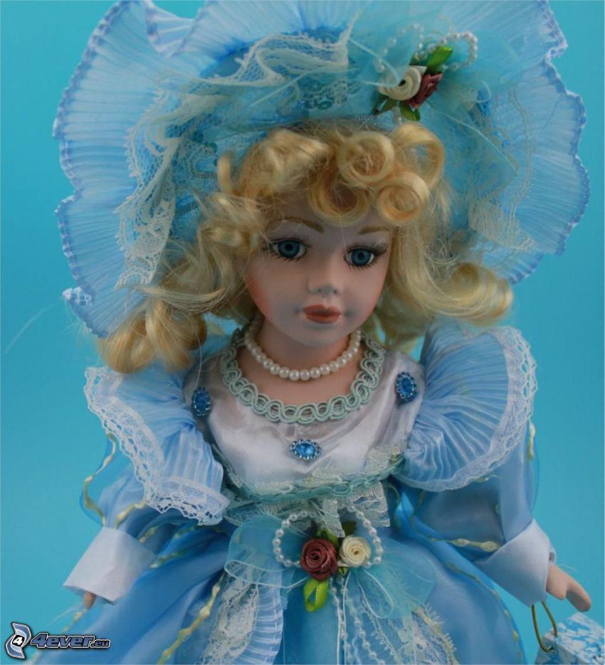 muñeca de porcelana, vestido azul, sombrero