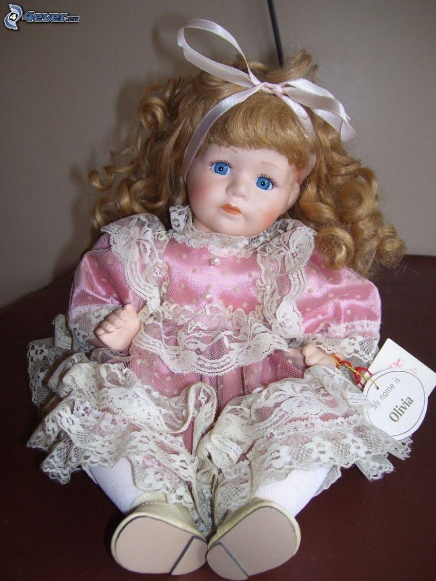 muñeca de porcelana, vestido de color rosa