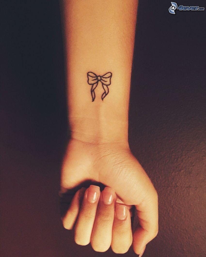 tatuaje, moña, muñeca de la mano