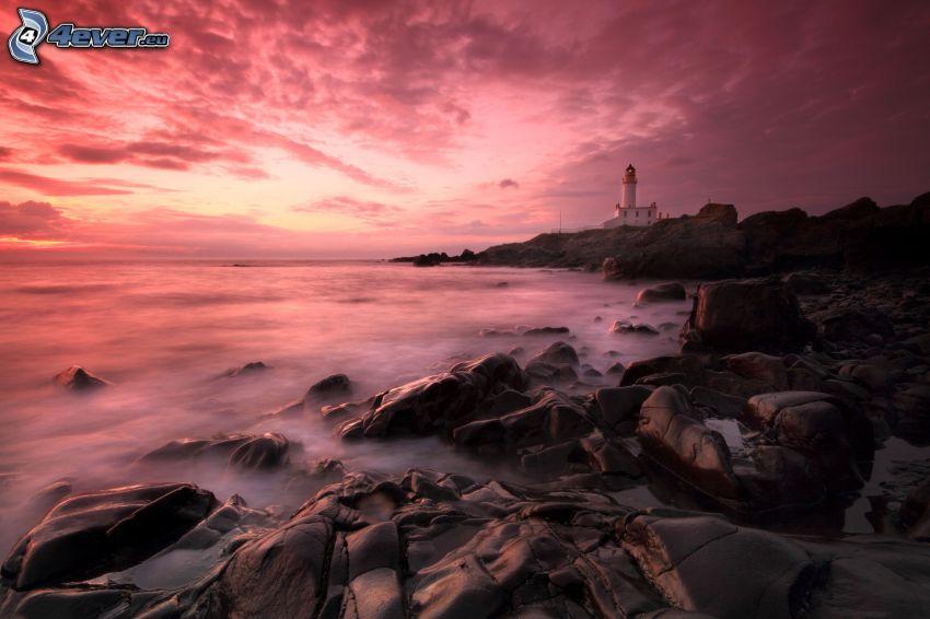 costa de piedra, mar, faro, cielo púrpura