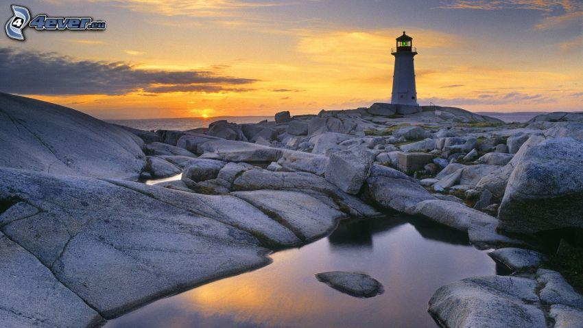 faro, piedras, puesta de sol en el mar