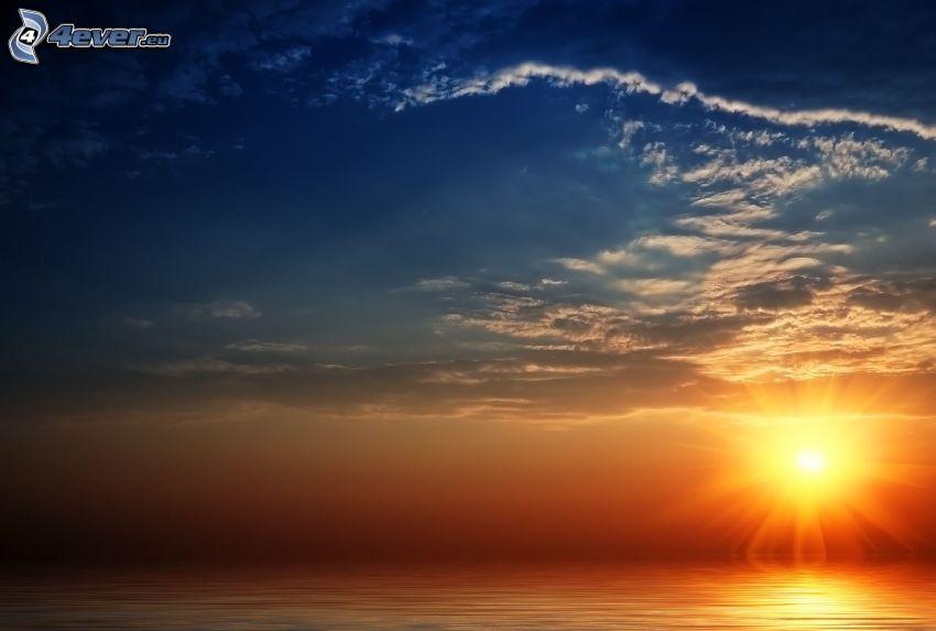 puesta de sol sobre el mar, cielo