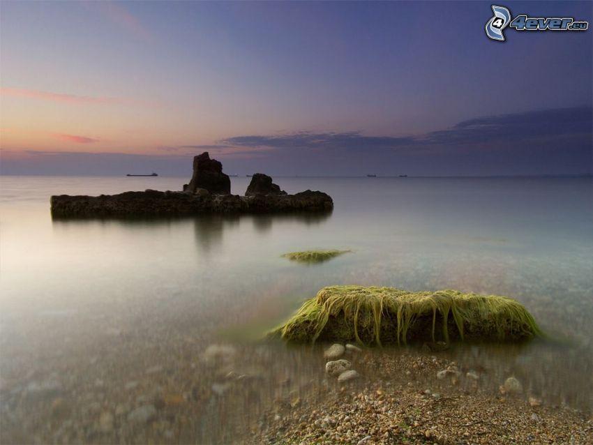rocas en el mar, salida del sol