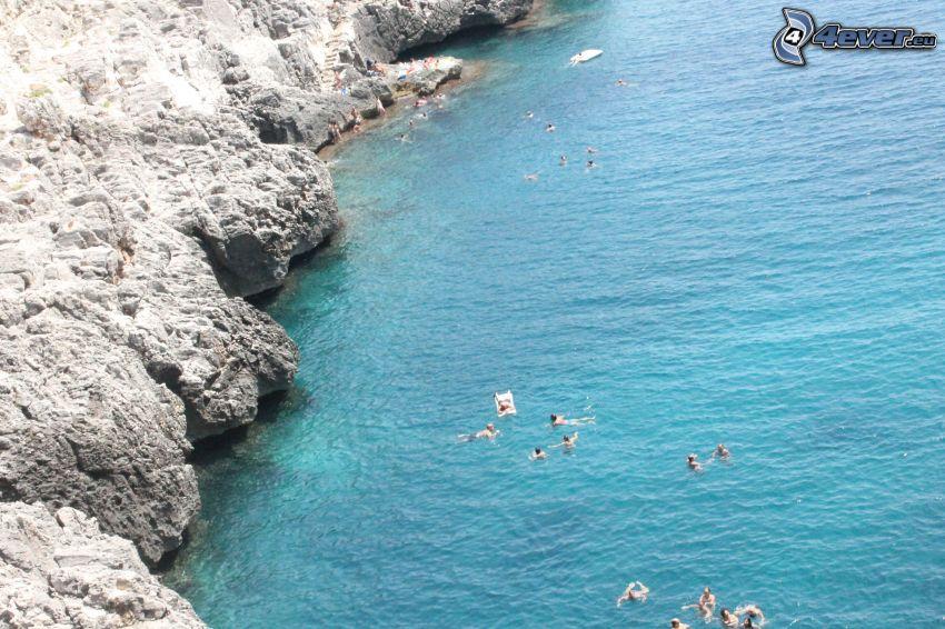 vista al mar, rocas, personas