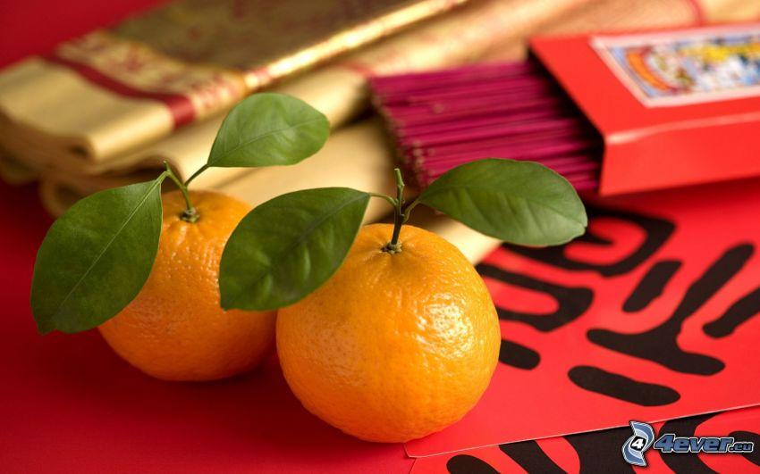 tangerinas, hojas verdes