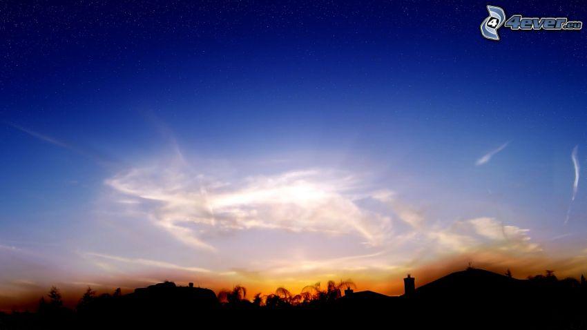 silueta del horizonte, después de la puesta del sol, cielo