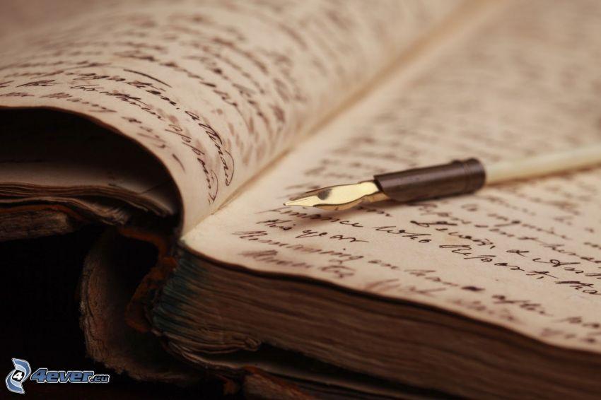 libro antiguo, pluma