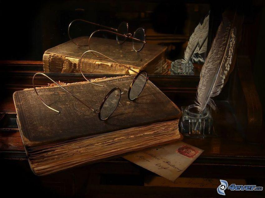 libros antiguos, gafas, plumas, carta