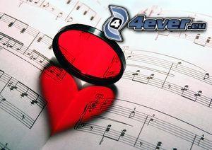 notas de música, corazón en el libro