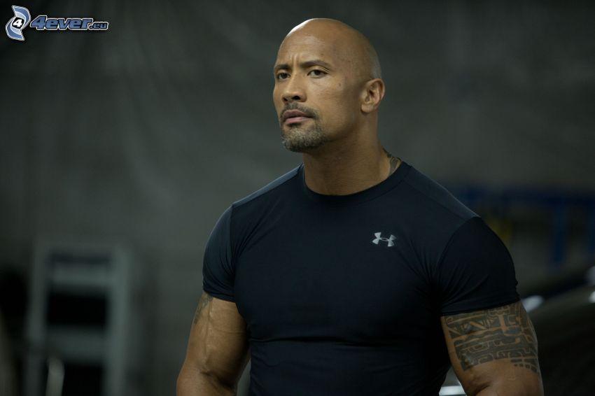 Dwayne Johnson, luchador, tatuaje en la mano