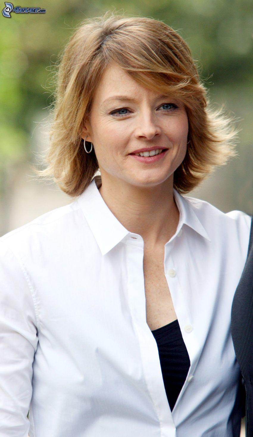 Jodie Foster, camisa blanca, sonrisa