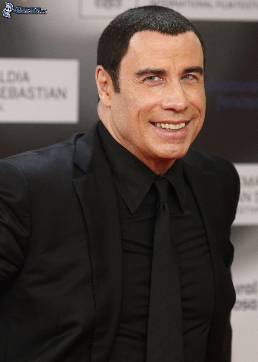 John Travolta, hombre en traje, sonrisa, mirada