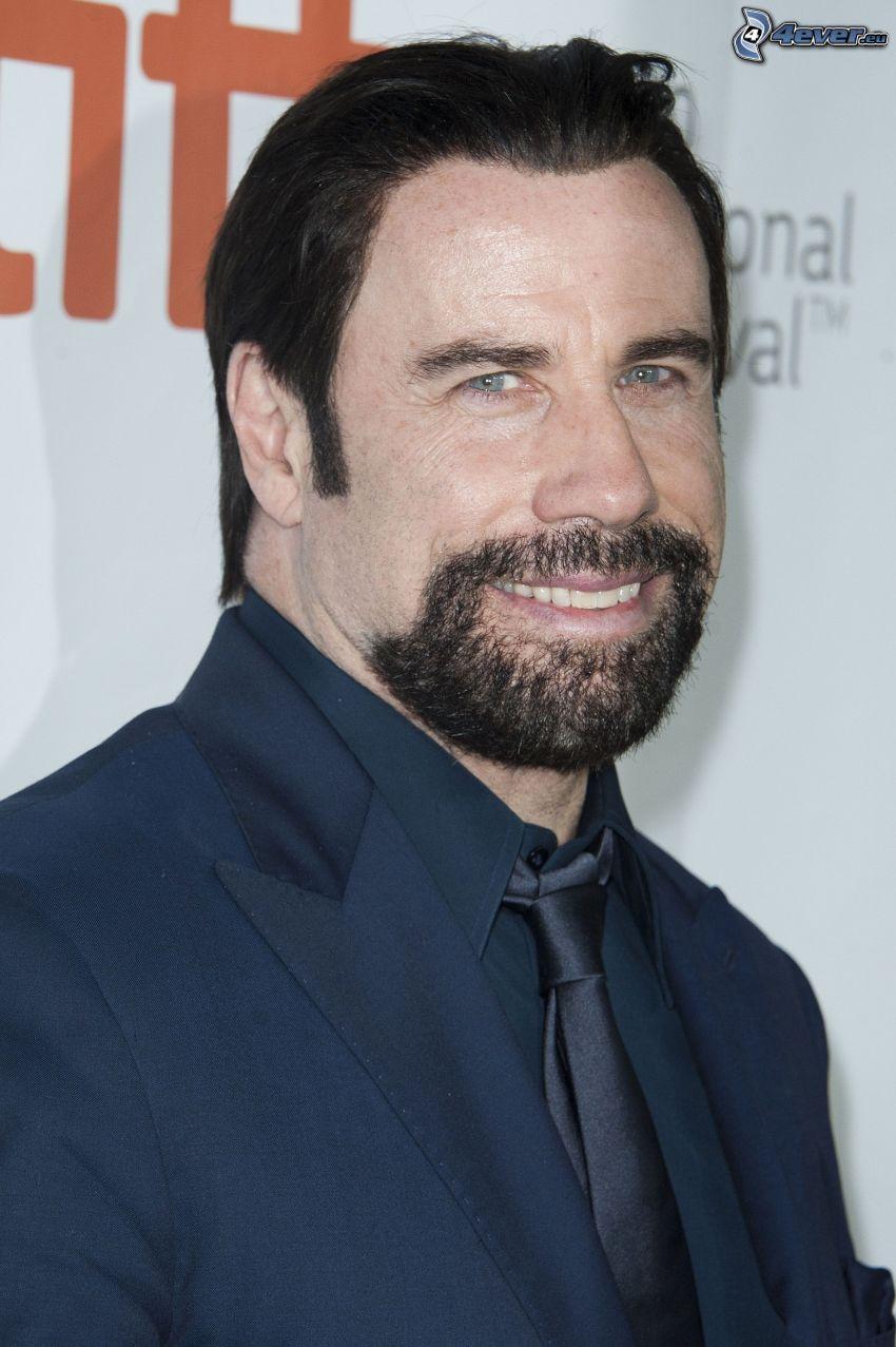 John Travolta, sonrisa, bigote, hombre en traje