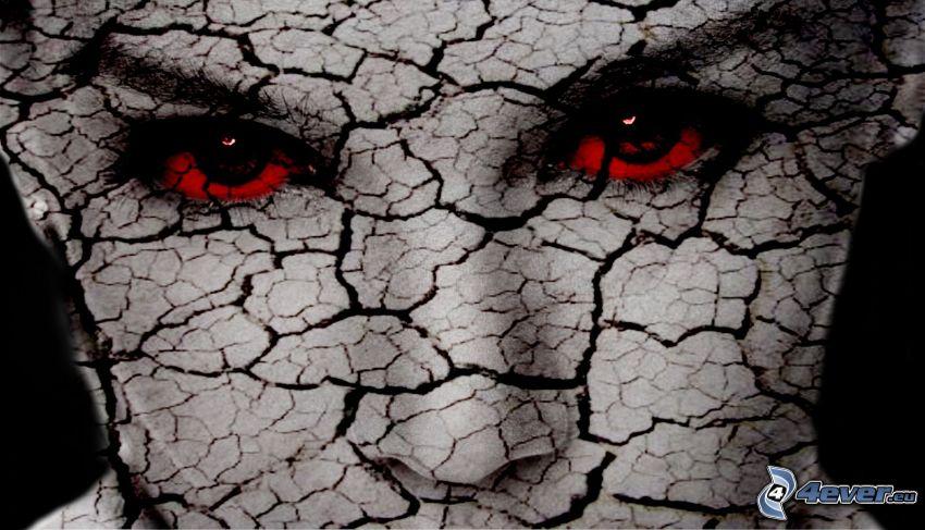 cara agrietada, ojos rojos