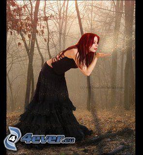 mujer en el bosque, pelirroja