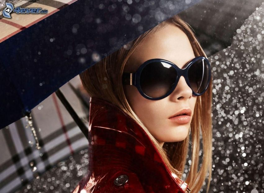 Cara Delevingne, modelo, gafas de sol, paraguas, gotas de lluvia