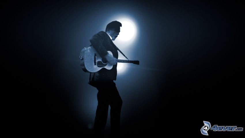 Johnny Cash, hombre con guitarra