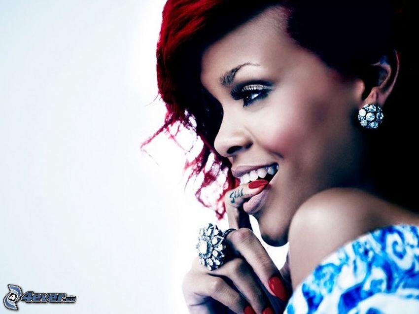 Rihanna, dedo en la boca, mirada seductora
