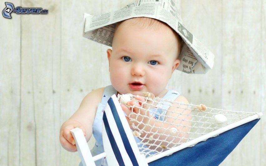 bebé, gorro, periódico