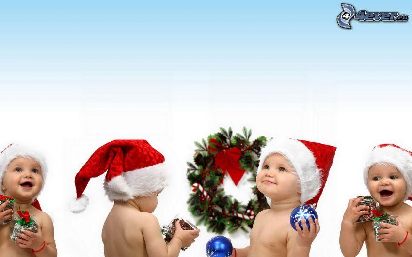 bebé navideño, gorra de San Nikolás, bolas de navidad, regalos, corona, alegría