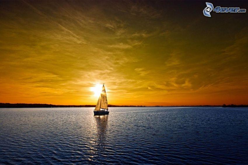 barco en el lago, puesta de sol anaranjada