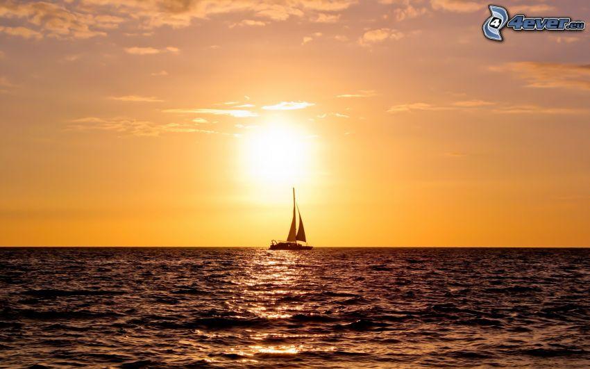 barco en el mar, puesta de sol sobre el mar