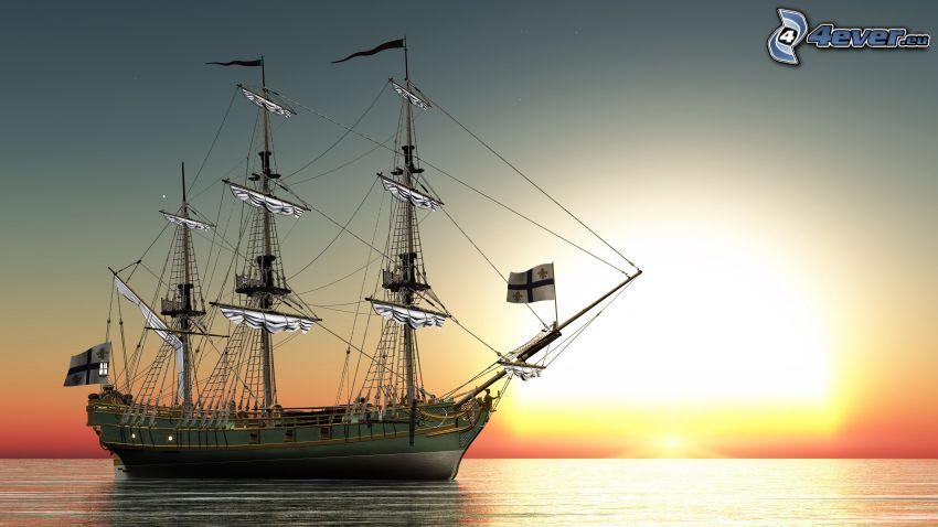 velero, puesta de sol sobre el mar