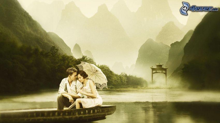 couple, parapluie, bateau sur la rivière, montagnes rocheuses