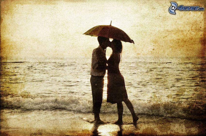 couple près de la mer, parapluie