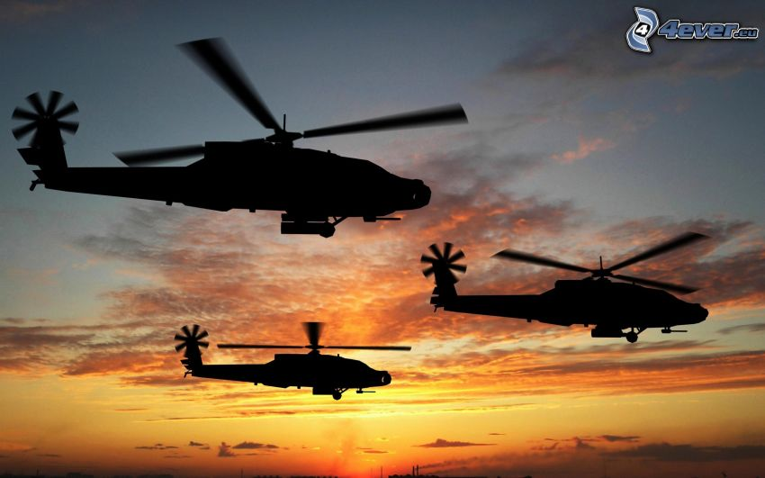 AH-64 Apache, silhouette d'hélicoptère, ciel orange, après le coucher du soleil