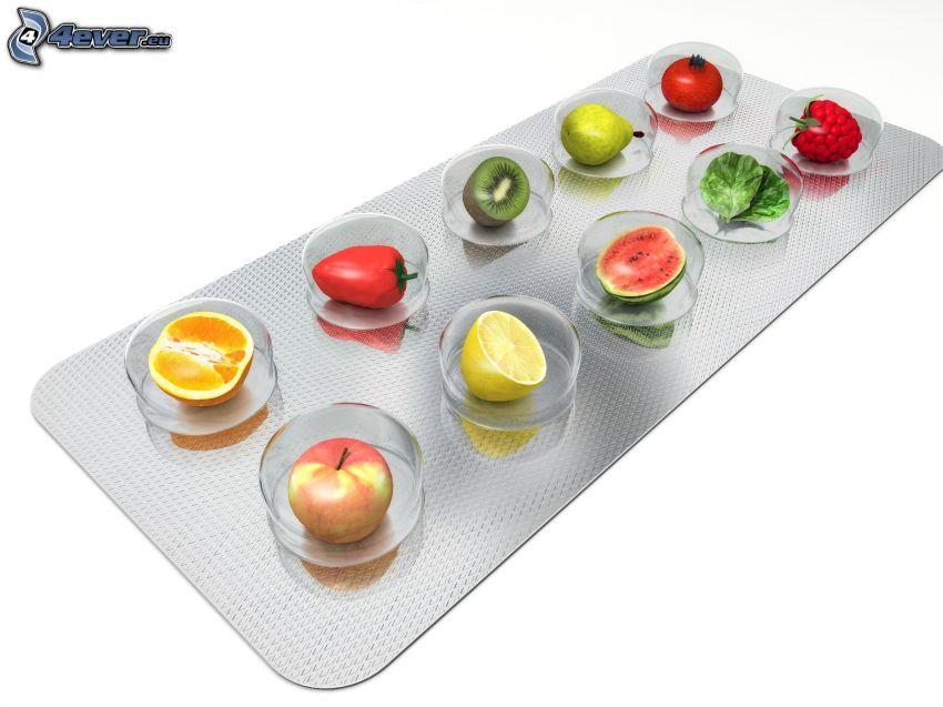 les pilules, fruits, pomme, orange, citron, poivre de Cayenne, pastèque, kiwi, salade, poire, framboise, tomate