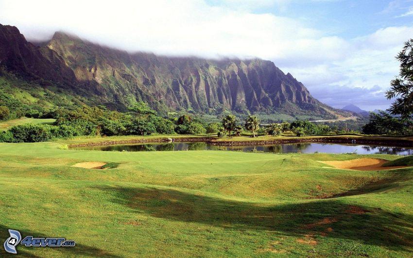 terrain de golf, lac, montagnes rocheuses