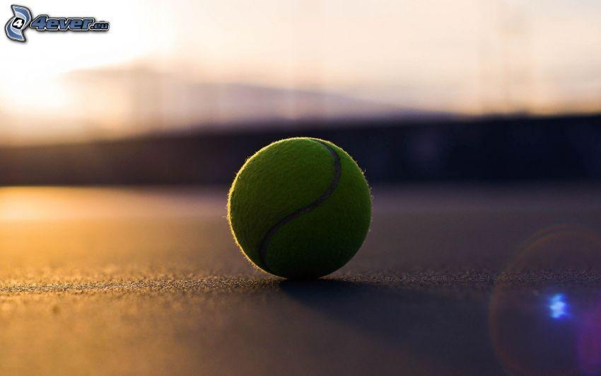 balle de tennis, coucher du soleil
