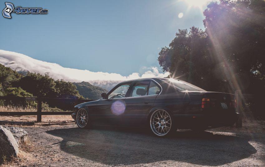 BMW 5, rayons du soleil