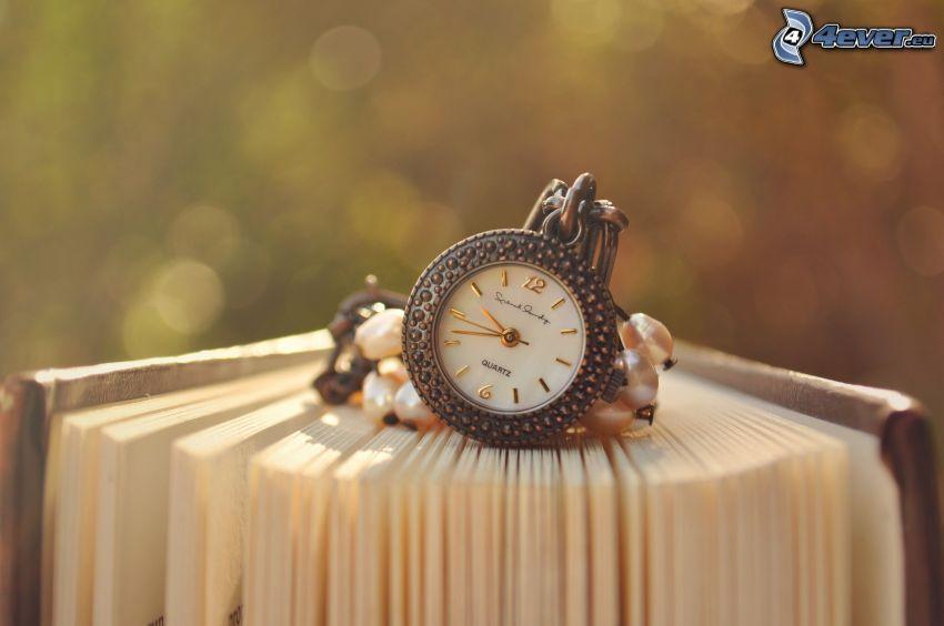 orologio, libro