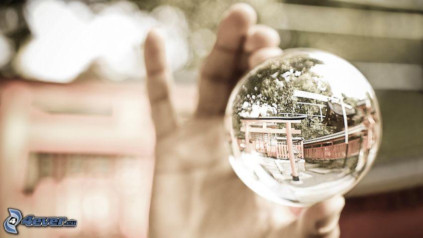 sfera di vetro, mano