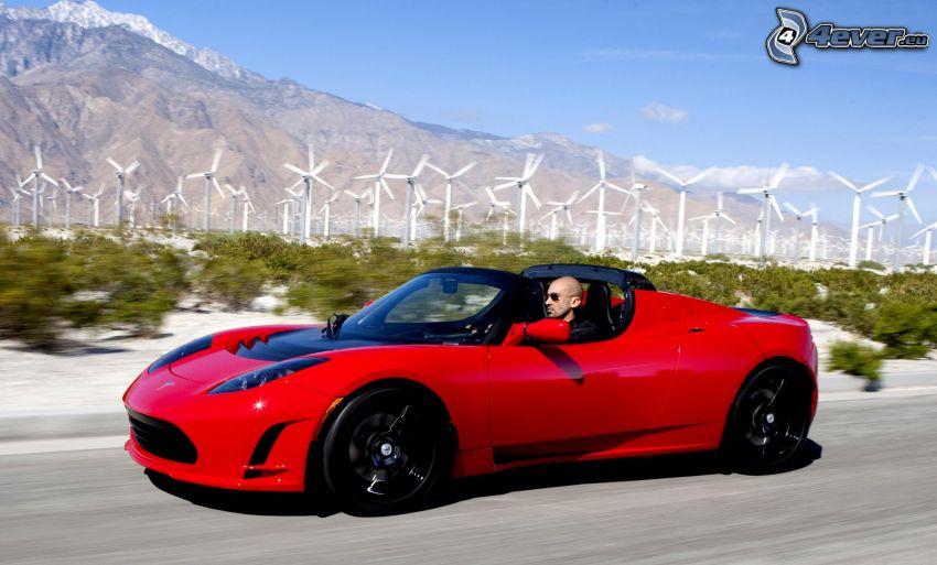 Tesla Roadster, centrale eolica, montagna rocciosa