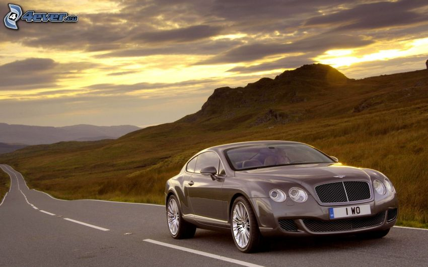 Bentley Continental, collina, sole dietro le nuvole, strada