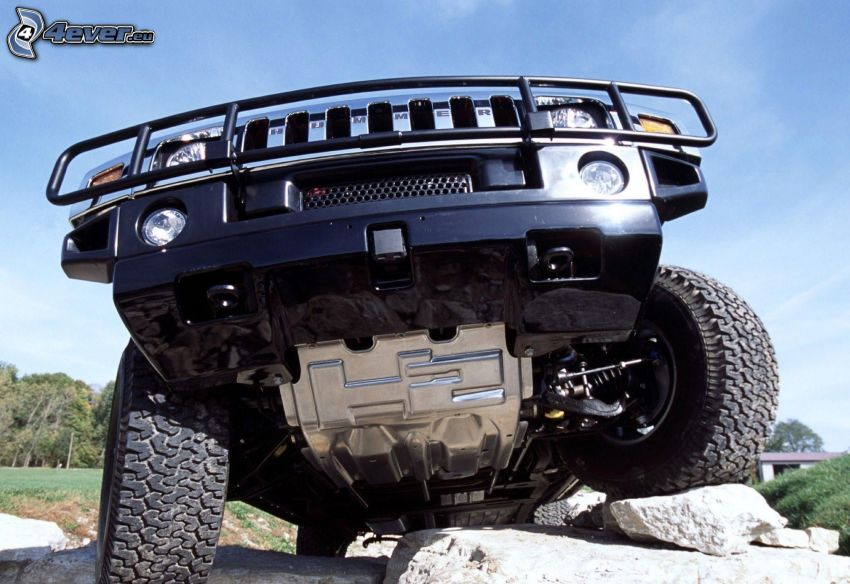 Hummer H2, auto terrano, rocce