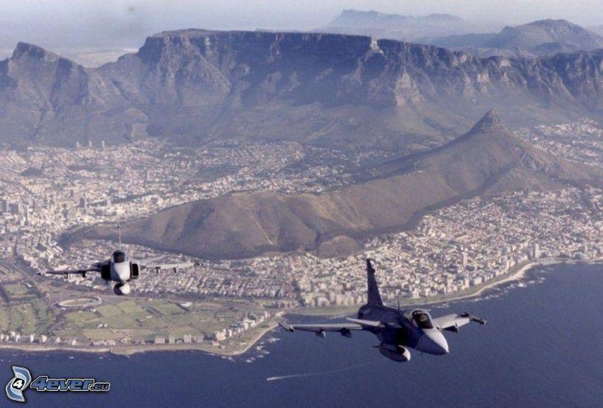 aerei da caccia, vista della città, montagne taglie, colline, mare