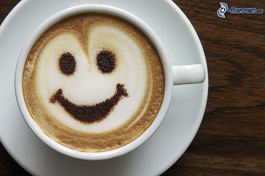 una tazza di caffè, faccina, latte art