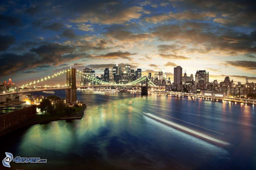 New York, ponte illuminato, il fiume